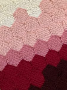 Close up of woven hexagons, showing all five colors used in the data visualization. This is data from around March 2020.